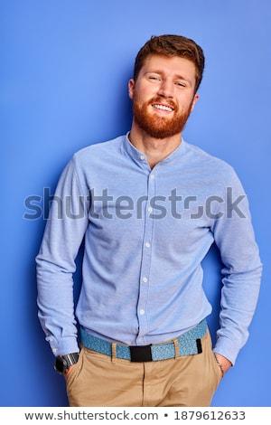 Optimistic grey-haired bearded businessman Stock photo © deandrobot