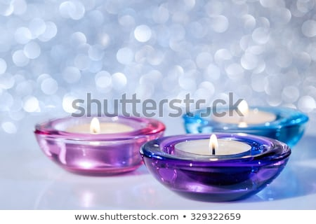 three glass candlesticks stock photo © ruslanomega
