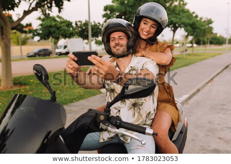 Couple sat by scooter Stock photo © photography33