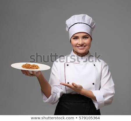 Female chef holding plate of healthy food Stock photo © wavebreak_media