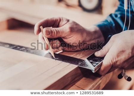 Carpenter measuring  Stock photo © Hofmeester