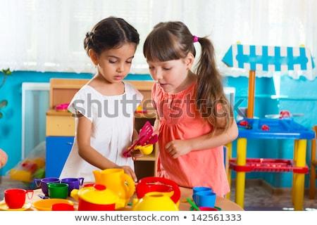 Jong meisje spelen speelgoed gelukkig kind speelgoed Stockfoto © monkey_business