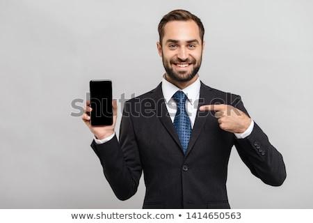 atraente · jovem · empresário · olhando · câmera · sorridente - foto stock © stokkete