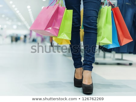 Сток-фото: Woman Legs In Red High Heels Carrying Red Bag