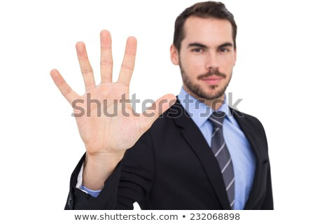 Businessman standing with fingers spread out Stock photo © wavebreak_media