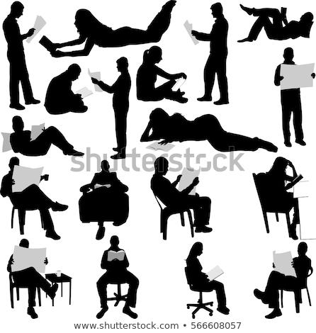 Adam oturma sandalye kitap içmek genç Stok fotoğraf © juniart