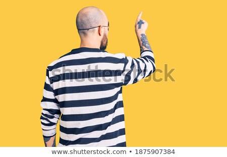 Guapo criminal las manos en alto masculino detrás Foto stock © stokkete