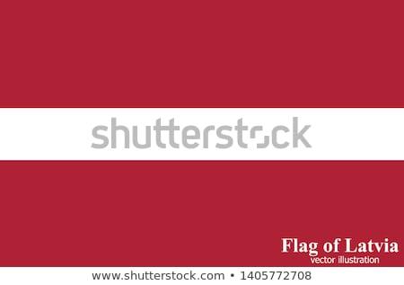 Lettország zászló póló üzletember mutat férfi Stock fotó © fuzzbones0
