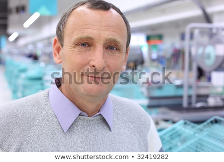closeup elderly man in shop with empty counters Stock photo © Paha_L