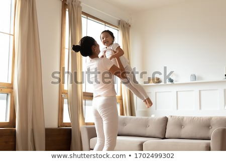 parents hold child on hands in playroom Stock photo © Paha_L