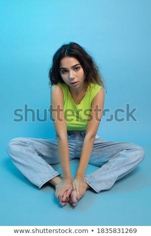 Thoughtful Girl Sitting In Studio Stock photo © monkey_business