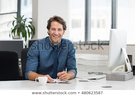 Portrait of a young businessman sitting  Stock photo © gravityimaging