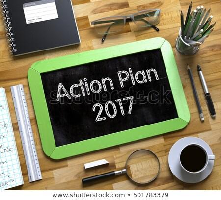action plan 2017 handwritten on small chalkboard 3d stock photo © tashatuvango