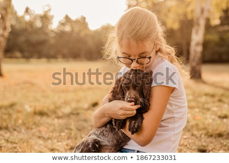 Young girl and her cocker spaniel puppy Stock photo © ozgur