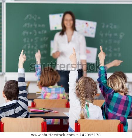 Iskolások kezek lány fiú osztályterem női Stock fotó © IS2