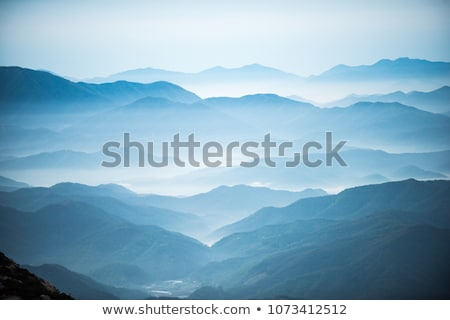 Sis bulut mavi dağlar ışık Stok fotoğraf © lovleah