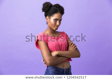 Photo of offended or naughty african american woman standing wit Stock photo © deandrobot