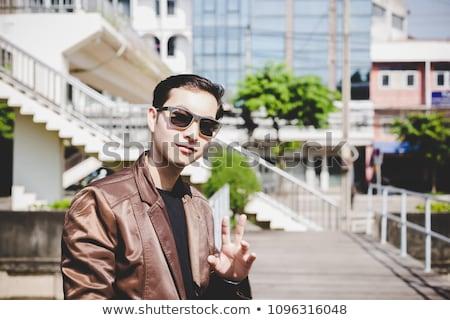 Retrato empresário jaqueta de couro olhando lado Foto stock © feedough