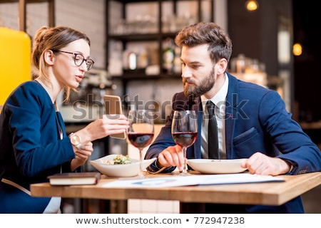 group of cheerful smart dressed friends stock photo © deandrobot