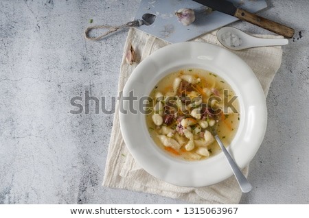 Smoked meat soup with pasta inside Stock photo © Peteer
