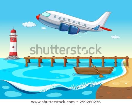 Uçak uçan deniz feneri örnek gökyüzü bulutlar Stok fotoğraf © colematt