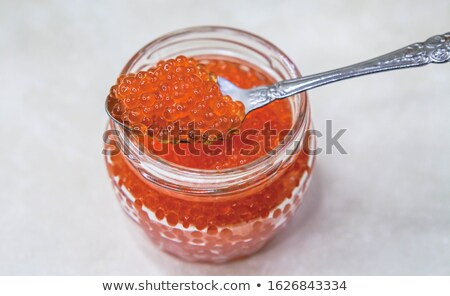 Spoon with a hill of red salmon caviar Stock photo © mayboro