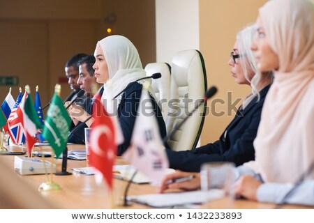 Row of serious intercultural delegates listening attentively Stock photo © pressmaster