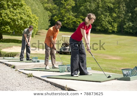 Woman practising to driving golf Stock photo © Kzenon