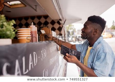 мужчины клиентов бумажник продовольствие грузовика улице Сток-фото © dolgachov
