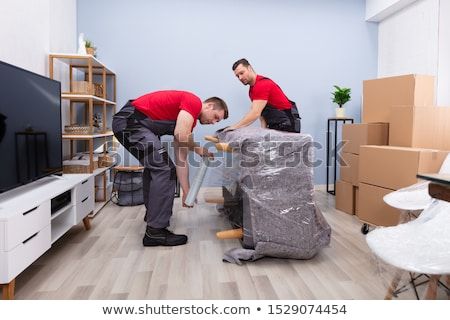 Two Male Mover Wrapping Furniture For Moving Stock photo © AndreyPopov