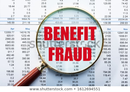 Magnifying Glass Over Benefit Fraud Text On Data Report Stock photo © AndreyPopov