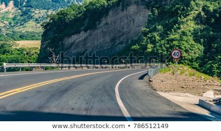 Сток-фото: Колумбия · шоссе · знак · зеленый · облаке · улице · знак