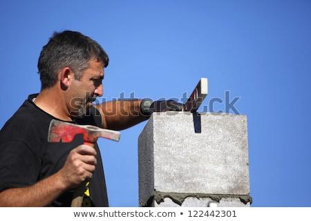 Kőműves készít tégla kéz fal fém Stock fotó © photography33