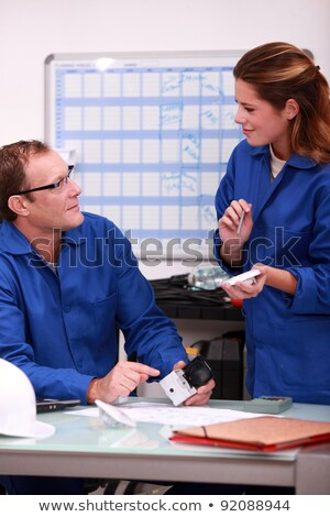 Electrician discussing parts in an office Stock photo © photography33