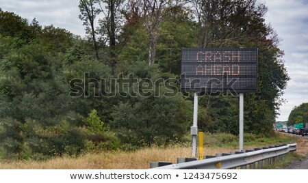A traffic guard holding up a sign Stock photo © photography33