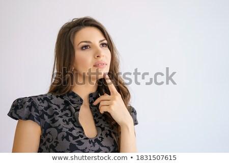 Mulher tocante queixo branco fundo Foto stock © wavebreak_media