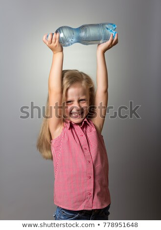 young blonde girl drinks water from his hand stock photo © justinb