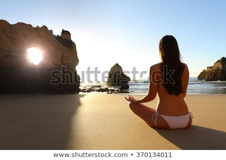 Gyönyörű nyugodt zen tini meditáció bikini Stock fotó © lunamarina