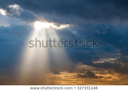 sun through  clouds Stock photo © taden