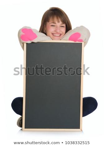 casual woman holding a blackboard stock photo © feedough