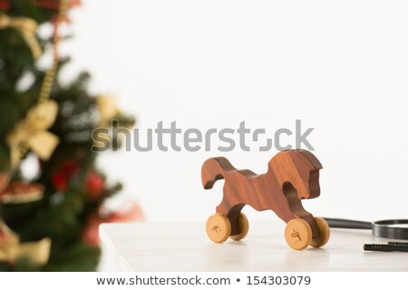 vintage wooden horse on santas work table christmas tree on ba stock photo © hasloo