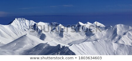 Panoramic view on off-piste slope and snowy plateau at nice day Stock photo © BSANI