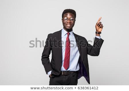 üzletember · mutat · valami · fehér · mosoly · modell - stock fotó © stockyimages