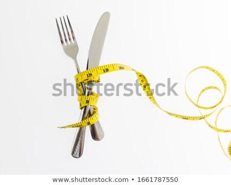 Medición cinta tenedor blanco alimentos fitness Foto stock © fuzzbones0