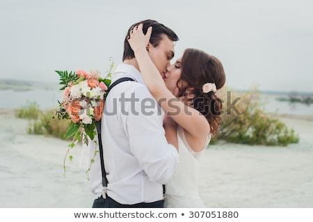 bride kisses fiance outdoor Stock photo © Paha_L