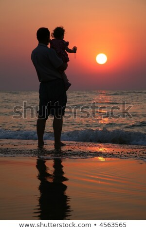 grandfather with the child against the background of sunset at sea in water stock photo © paha_l