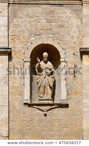 Statue on the Church of San Pietro in Volterra Stock photo © Digifoodstock
