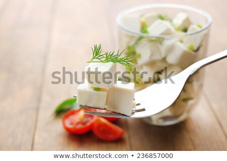Cut pieces of feta cheese and fork Stock photo © ozgur