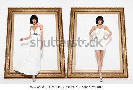 Güzel esmer kadın poz uzun altın Stok fotoğraf © Victoria_Andreas
