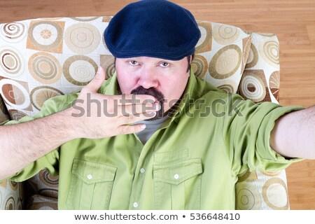 Sovrappeso uomo basco bacio poltrona Foto d'archivio © ozgur